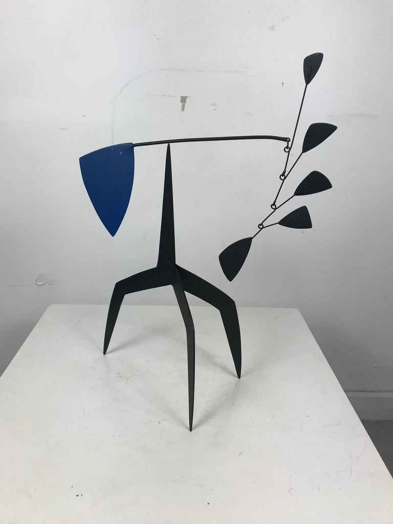 Amazing Kenetic / stabile motion sculpture hand built and designed by Graham Sears, primarily black with a blue accent. Acclaimed artist Sears, born in Buffalo, NY in 1953, is an alumni of both The Nichols School and The University of Buffalo.