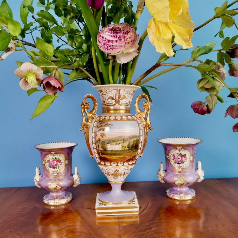 This is a stunning vase made by Grainger in Worcester around the year 1820. The vase is in the Empire or Regency style and has a lilac ground with a beautiful painting of a named view of Hagley in Worcestershire.  Grainger was one of the leading