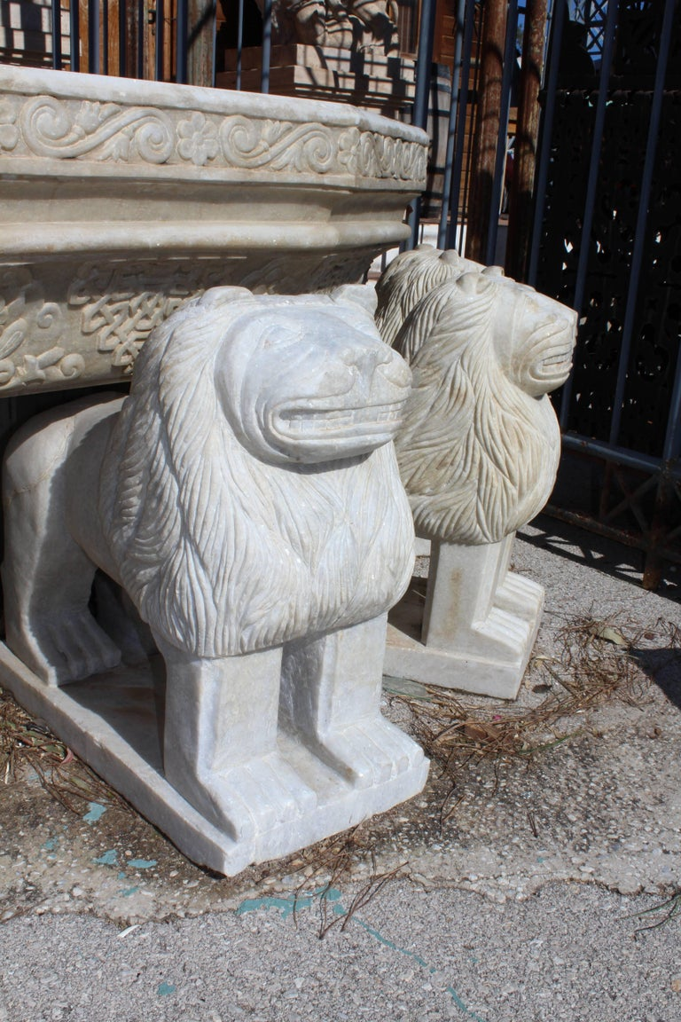 Reproduction inspired in World Heritage lion fountain in Alhambra, that gives name to the courtyard and palace. A giant marble tier is held by twelve lions and decorated in typical Andalusi geometric pattern. Hand-carved in highly crystallized local