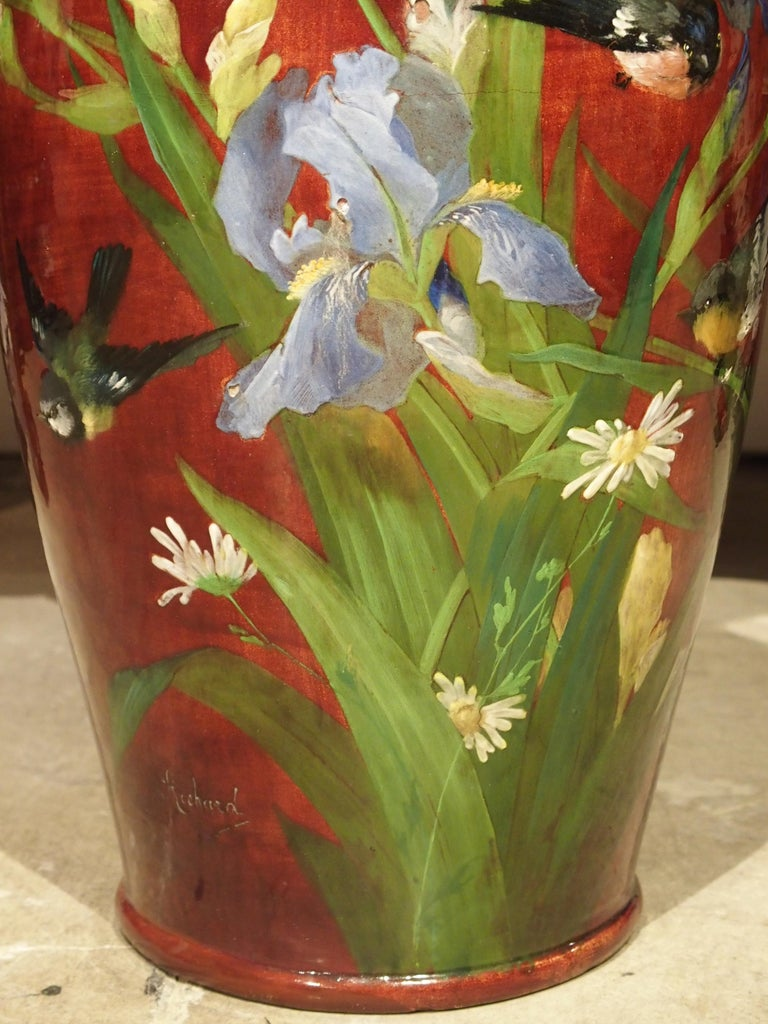 This large antique French vase was created circa 1890 in a faiencerie in the town of Bourg-la-Reine, which is a suburb of Paris. This commune is considered to be part of the Parisian school of barbotine and faienceries, and in the late 1800s, they