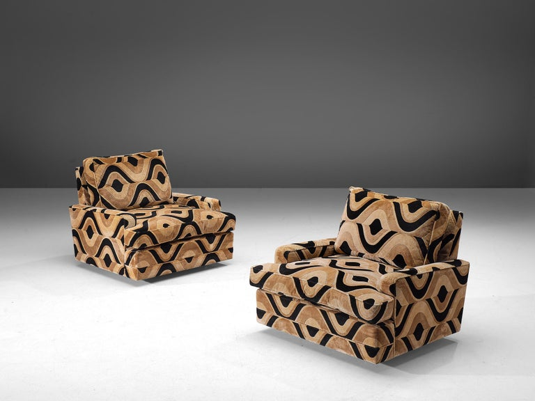 Pair of lounge chairs, black and beige patterned fabric, France, 1970s.