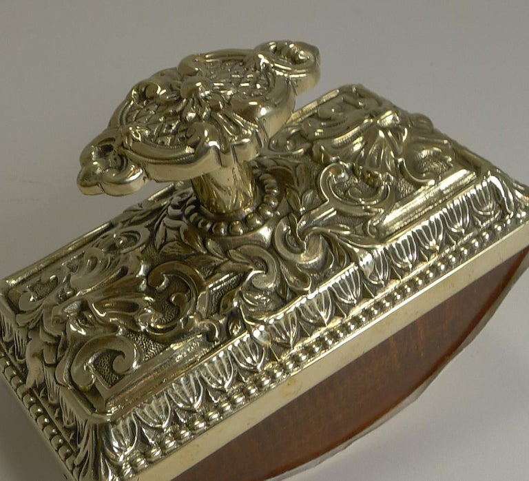 A most impressive desk top rocking blotter, beautifully decorated and very heavy being made from solid cast brass. The fabulous grand handle can be unscrewed to dismantle the blotter to re-fuel with fresh blotting paper when required.