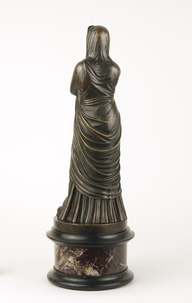 Grand Tour bronze figure of Pudicity, the classically draped standing female wearing a headdress and gazing serenely forward, mounted to a marble plinth, marked