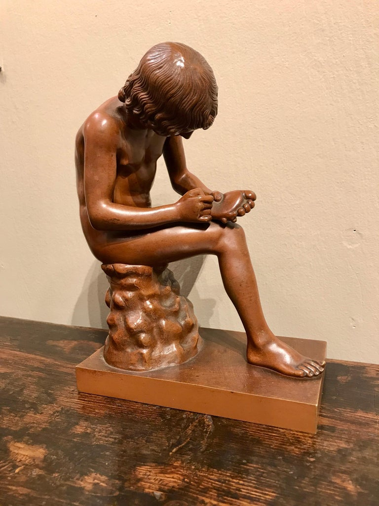A wonderful 'Grand Tour' cast of 'Spinaro', also known as 'The Boy with Thorn' with a foundry mark of R. Bellair & Co., Berlin. This foundry was known for its rich and luminous copper toned patina that gives the sculpture a life-like quality. After