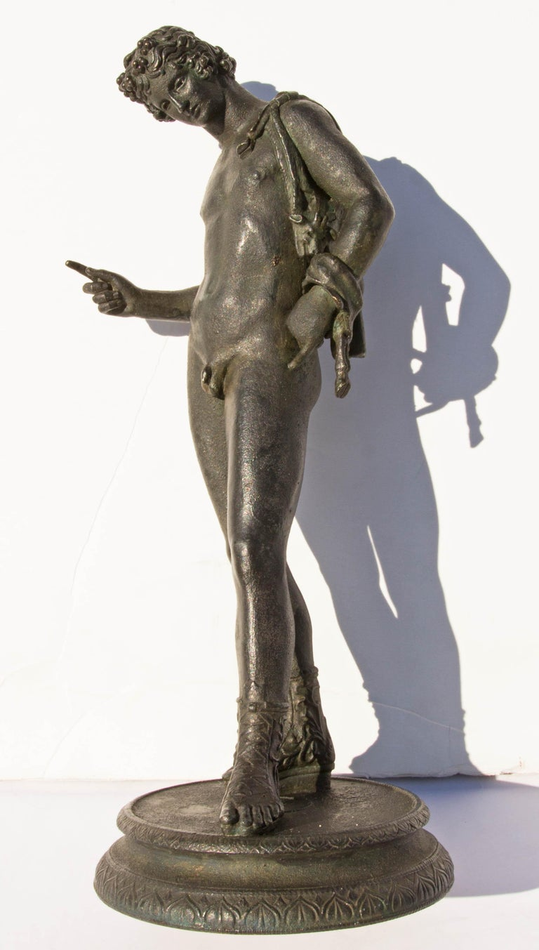 Grand tour bronze sculpture of Narcissus after the original found in 1862 at Pompeii. When first found in Pompeii it was identified as Narcissus. Years later it was identified as Dionysus, 19th century.