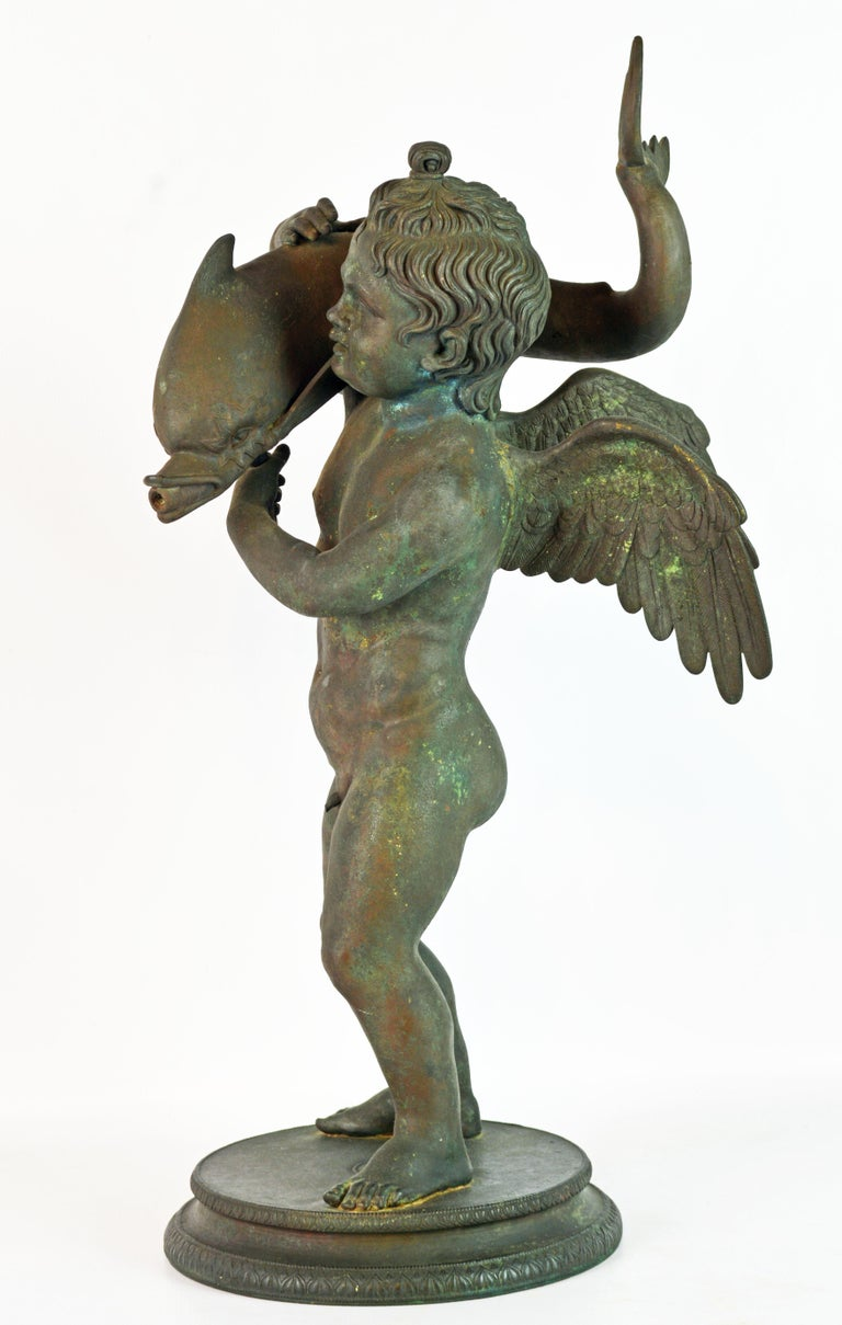 Rare and beautiful 19th century Neapolitan Grand Tour bronze fountainhead of the 'Amore con Delfino'. Cupid with dolphin, after the antique. Good large size version in dark 'archaeological verdi gris Pompean patination' after the original fountain
