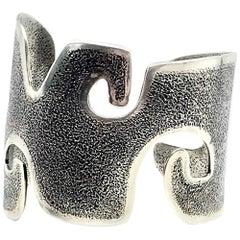 Grandmother, Melanie Yazzie contemporary cast silver wide cuff bracelet  Navajo