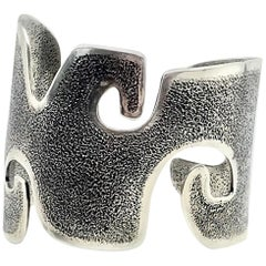 Grandmother, Melanie Yazzie contemporary cast silver wide cuff bracelet  Navajo