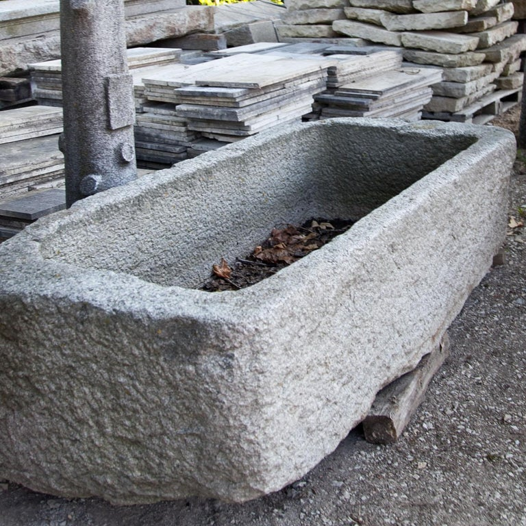 Rectangular basin out of granite. Very beautiful natural patina and structured surface.