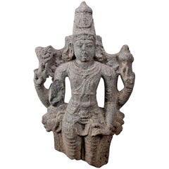 Granite Shiva with Attributes in His Hands and Conical Tiara
