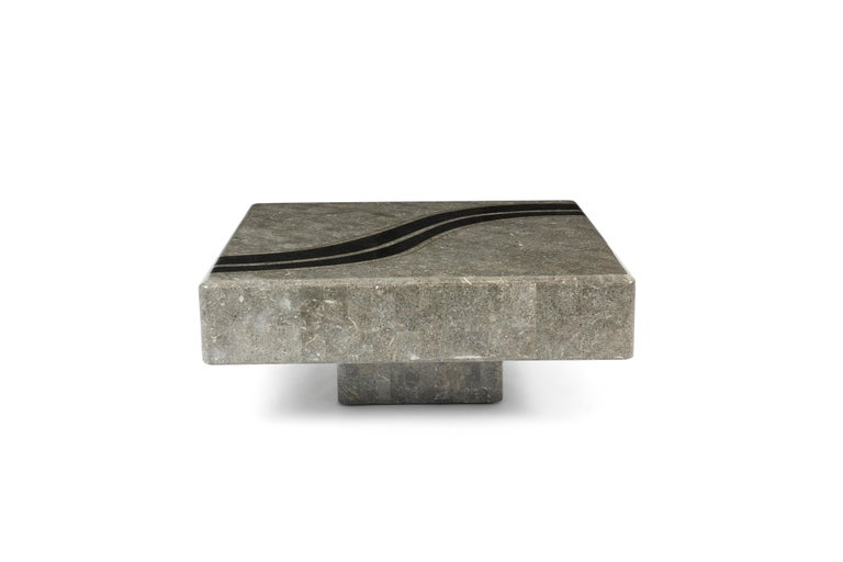 Coffee table in tessellated stone with graphic marble inlays, circa 1980s.