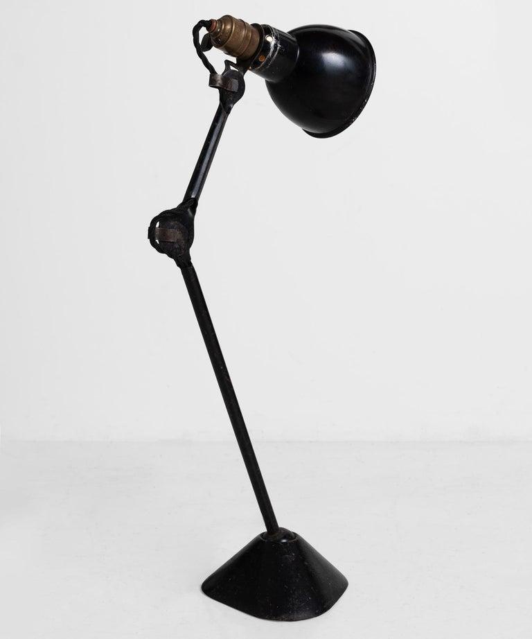 Gras Lamp No. 205, France, circa 1930.  Designed by Bernard-Albin Gras, with original black patina and iron base.