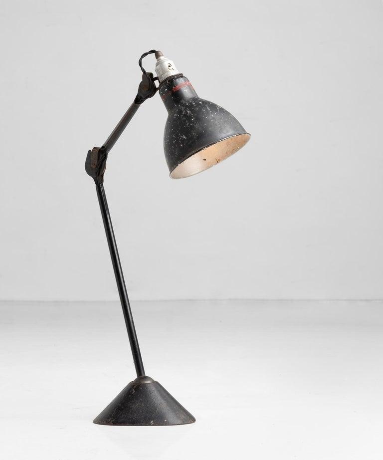 Gras lamp no. 205, France, circa 1930  Designed by Bernard-Albin Gras, with original black patina and iron base.