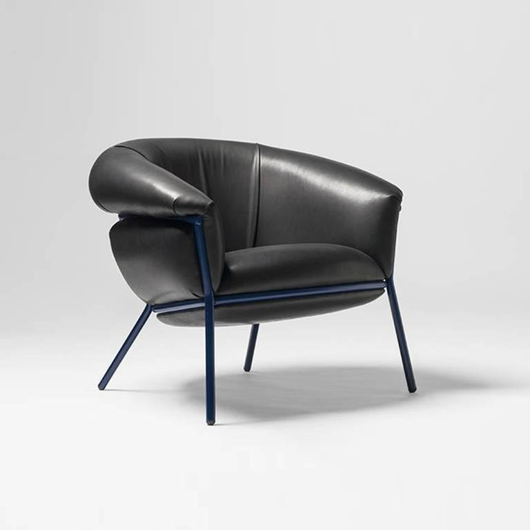 An iron tubular (25mm) structured armchair. Seat and backrest upholstered in leather.  The leather upholstery oozes over the bare iron structure to contrast with the most luxurious touch of the skin.