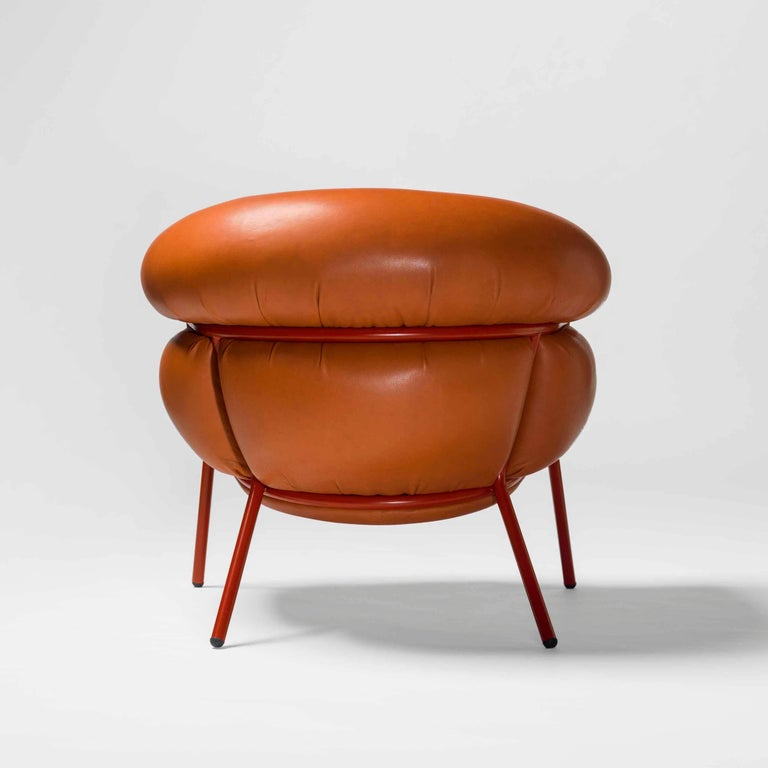 Armchair designed by Stephen Bruks manufactured by BD Barcelona.  An iron tubular (25mm) structured armchair. Seat and backrest upholstered in leather.  We have the possibility in different colors.  The leather upholstery oozes over the bare