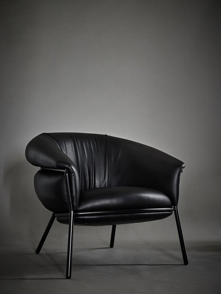 """""""Grasso is not fat. Grasso is more than fat. It's overflowing."""" This is how Stephen Burks sums up his new collection for BD.  An armchair that pursues a visual """"ultra-comfort"""", and invites you to sit on it.  The leather upholstery oozes over the"""