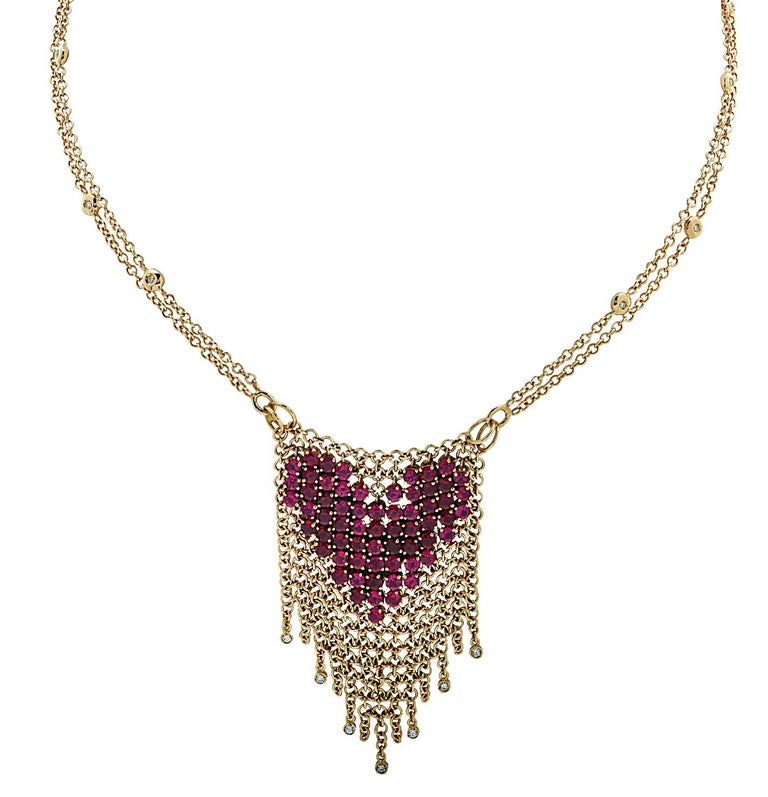 Delightful Garavelli Necklace crafted in Italy in 18 karat yellow gold, featuring 63 Pink Tourmalines weighing approximately 6.50 carats total, and 18 round brilliant cut diamonds weighing approximately .30 carats total, G color, VS clarity. Rows of