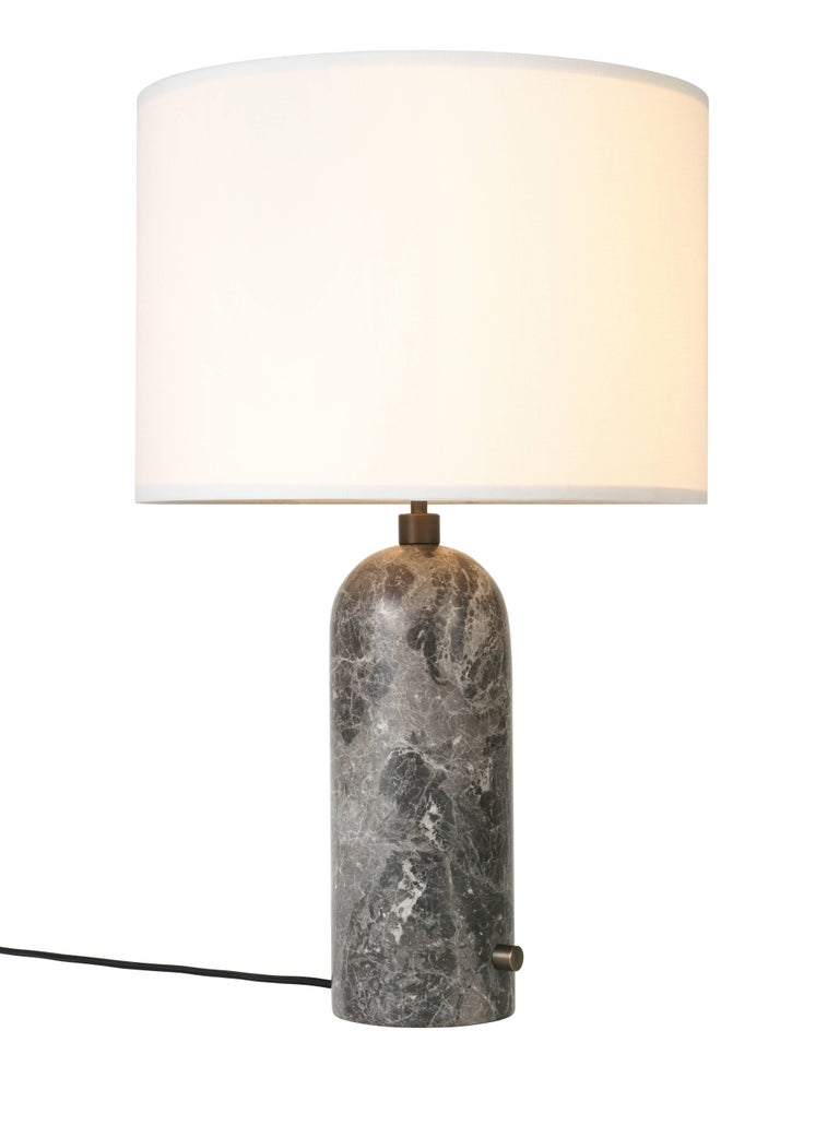 Gravity, grey marble table lamp Dimensions: 65 x 41 x 41 cm Material: Marble Designer: Louis Weisdorf Produced by Gubi in Denmark  The new Gravity collection designed by Space Copenhagen, consisting of a table lamp and a floor lamp, is