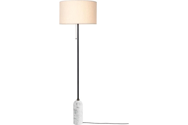 The new Gravity collection designed by Space Copenhagen, consisting of a table lamp and a floor lamp, is aesthetically contrasting strength and fragility. Taking its name from the lamp's distinctive balance between the anchoring of the heavy,