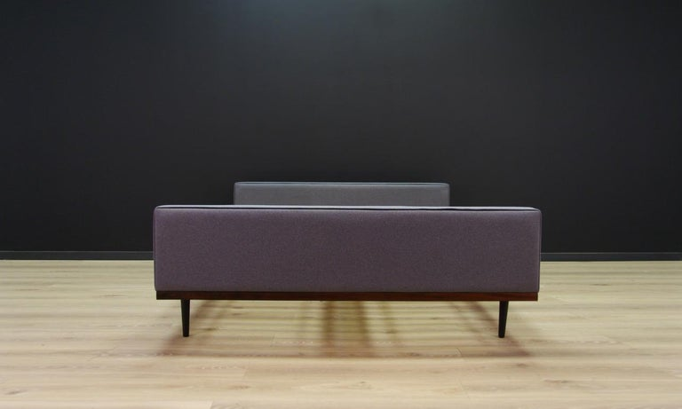 Amazing Scandinavian bed from the 1960s-1970s, a Minimalist form. Remarkable construction veneered with rosewood, a new gray fabric. Preserved in good condition (minor scratches and bruises), directly for use.  Dimensions: Height 58 cm, height of