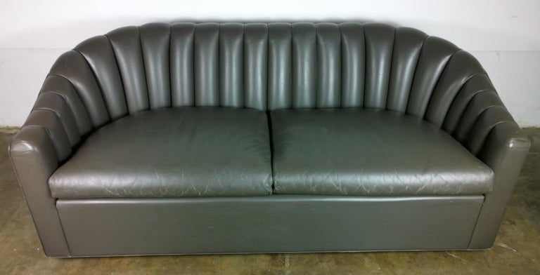 Offered is a Mid-Century Modern signed Jack Lenor Larson, Ward Bennett style beautiful and elegant grayish brown (milk chocolate) channel back leather two-cushion seat petite sofa or loveseat. The leather has a very rough hewn Ralph Lauren look.