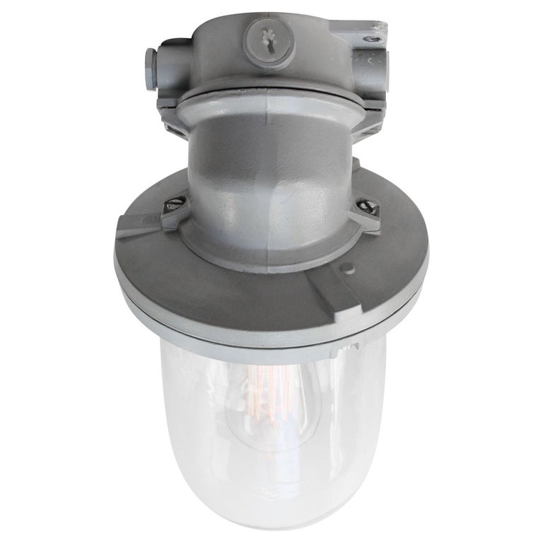 Dutch industrial wall lamp made by Industria Rotterdam Grey aluminum with clear glass  Weight: 2.20 kg / 4.9 lb  Priced per individual item. All lamps have been made suitable by international standards for incandescent light bulbs,
