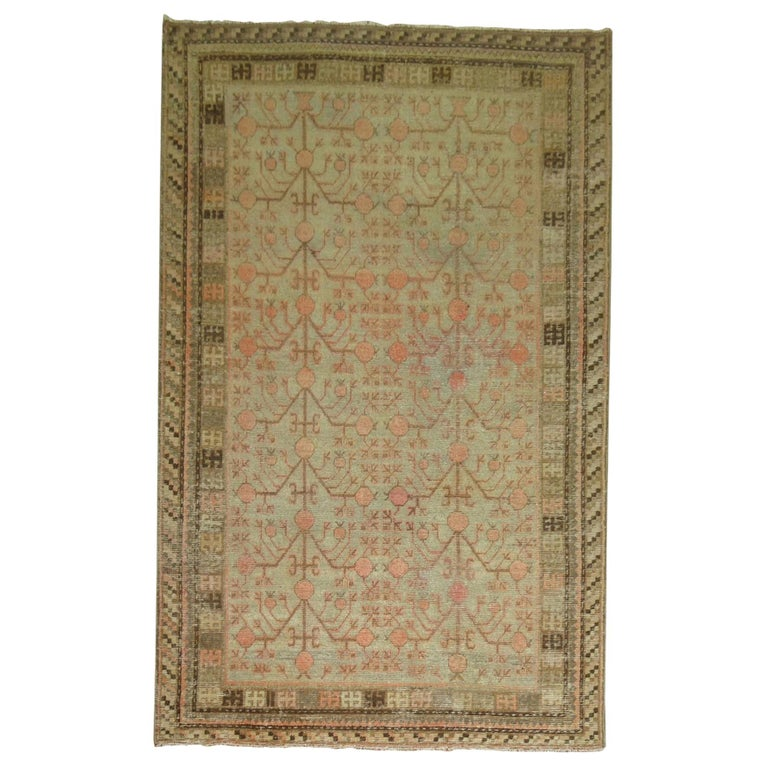 Gray Coral Antique Khotan Pomegranate Early 20th Century Rug For Sale