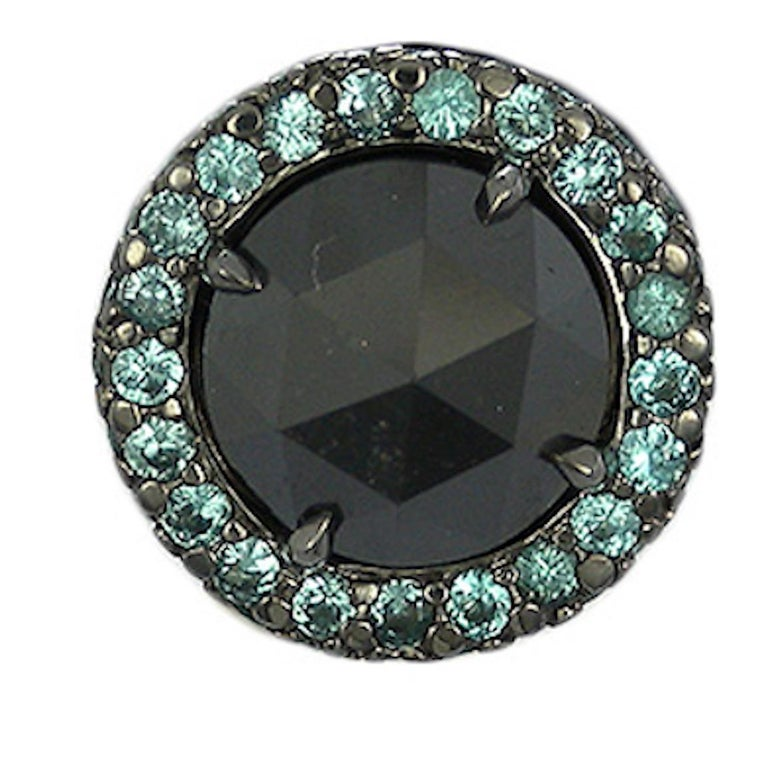 Features elegant round cut Gray Diamond surrounded by a micro pavé single row of sparkling round Paraiba Tourmaline set in White Gold.  Earrings Details :   Gray Diamond : 2.92 Total carat weigh  Paraiba Tourmaline : 0.60 Total carat weigh.