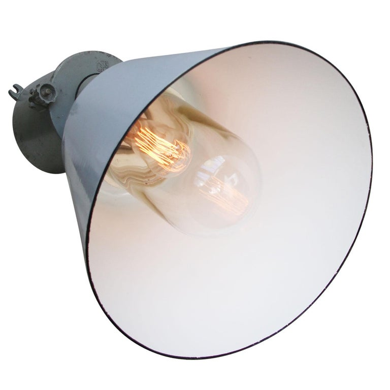 large industrial wall light by ELBO grey enamel, cast aluminium wall mount, clear glass  Weight: 4.20 kg / 9.3 lb  Priced per individual item. All lamps have been made suitable by international standards for incandescent light bulbs,