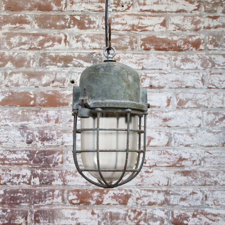 Hungarian Gray Metal Vintage Industrial Clear Glass Pendant Cage Light For Sale