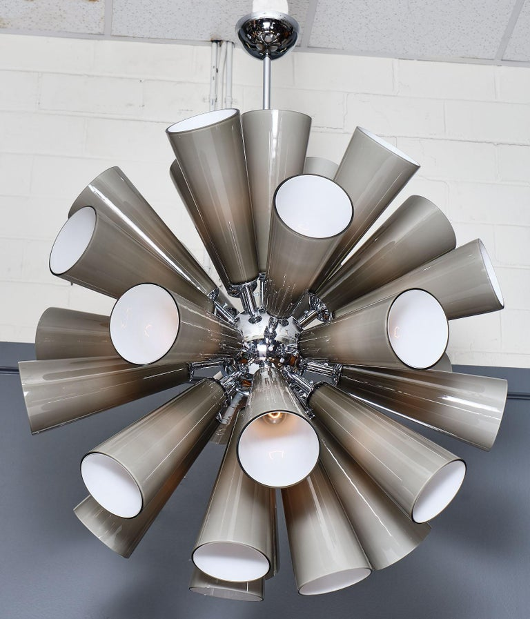 Murano glass gray sputnik chandelier featuring multiple blown glass components in conic shapes. Each glass piece has a double layer of white glass inside and gray outside, which gives the fixture a very smooth glow. The structure is chrome and has