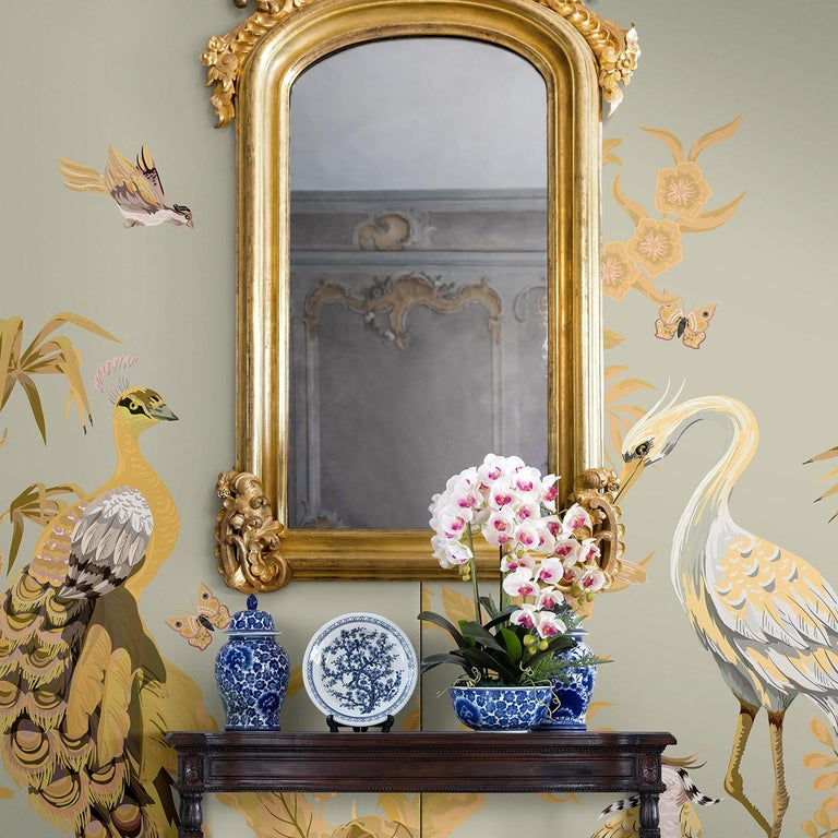 This elegant artwork depicts stately birds in an exotic garden in the surprising, sophisticated combination of gray, gold and white. The peacock and heron's collection evokes the richness of 18th century decorative art interpreted in unique designs