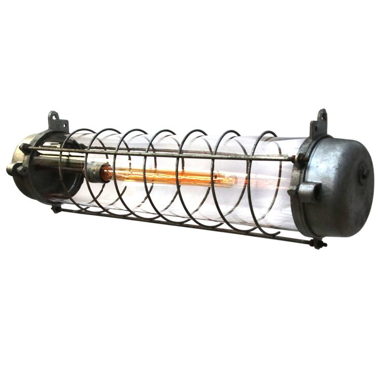 Industrial cast aluminum light. Clear glass.   Weight 3.0 kg / 6.6 lb  Priced per individual item. All lamps have been made suitable by international standards for incandescent light bulbs, energy-efficient and LED bulbs. E26/E27 bulb holders