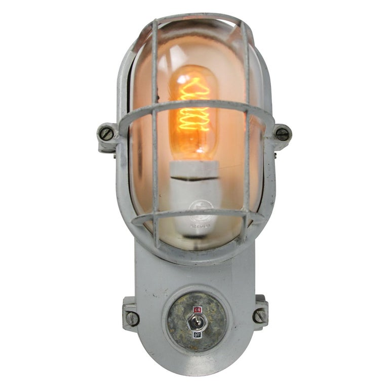 Industrial wall ceiling scones by Industria Rotterdam cast aluminum, clear glass and on / off switch  cast aluminum, clear glass, integrated on/off switch  Weight: 1.88 kg / 4.1 lb  Priced per individual item. All lamps have been made