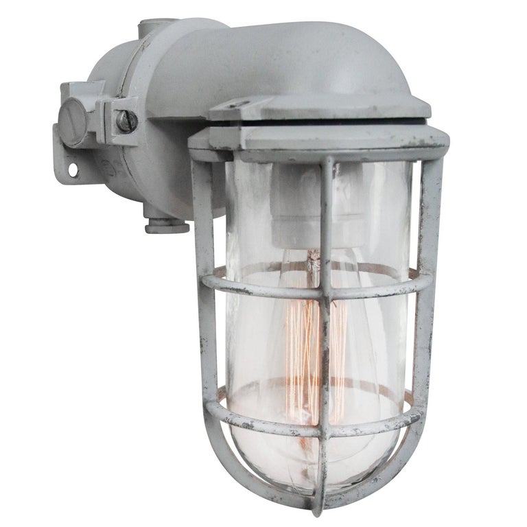 Industrial wall ceiling scones by Industria Rotterdam cast aluminum, clear glass.  Weight: 1.70 kg / 3.7 lb  Priced per individual item. All lamps have been made suitable by international standards for incandescent light bulbs, energy-efficient