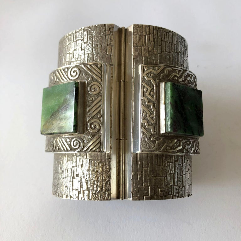 Important Aztec Peruvian modern sterling silver and malachite linked cuff bracelet by Graziella Laffi circa 1965.  Bracelet consists of four panels of etched sterling silver, each one patterned differently from the next and holding a 1