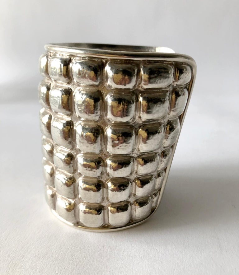 Important hand made sterling silver cuff bracelet with repousse´ waffle design created by architect and jeweler Graziella Laffi of Lima, Peru.  Cuff measures 9