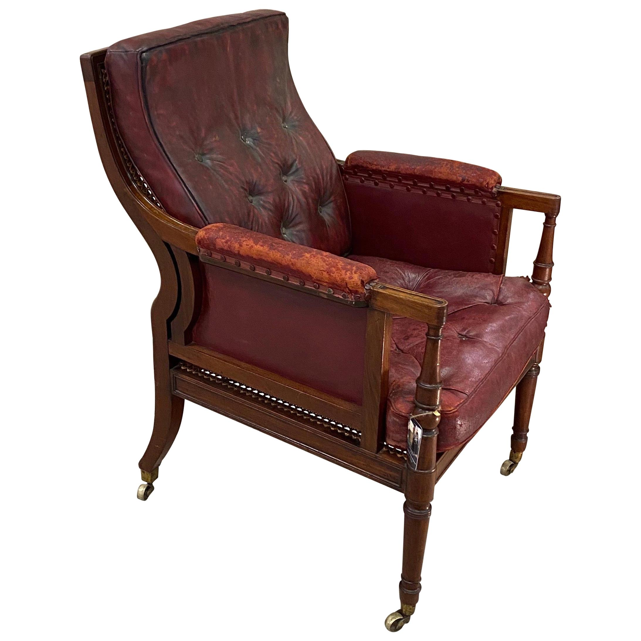 Great 19th Century English Mahogany and Cane Library Chair with Leather Cushions