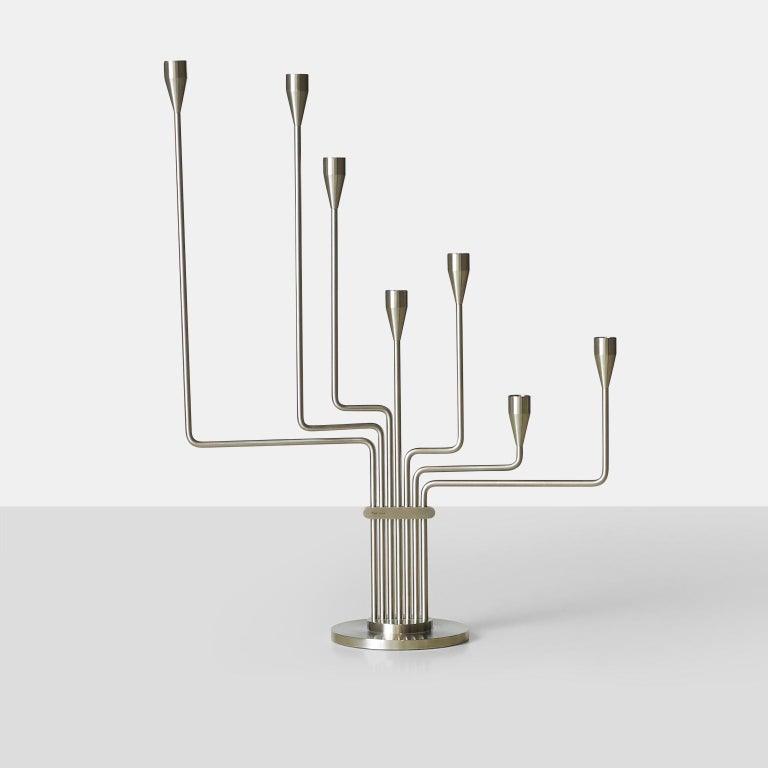 """A Piet Hein candelabra in brushed steel. Known as either """"Big Dipper"""" or """"The Great Bear"""", it was designed by Hein during his time in Argentina to remind him of his home in Denmark. The arms of the candelabra are adjustable."""