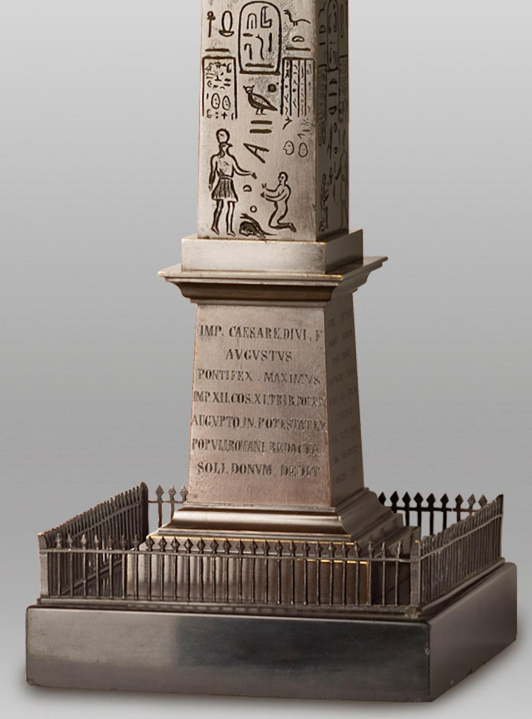 Great obelisk in patinated bronze, first half of the 19th century. After the original in Rome Piazza del Popolo.