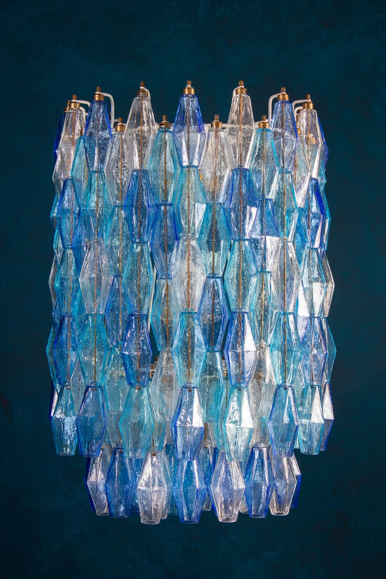 This fantastic pair of chandelier consists with circa 200 colored Poliedri glass of Murano. Sapphire color variation with heavenly and aquamarine precious Poliedri. Measures: Height without chain and canopy 88 cm (35inches). With chain and canopy