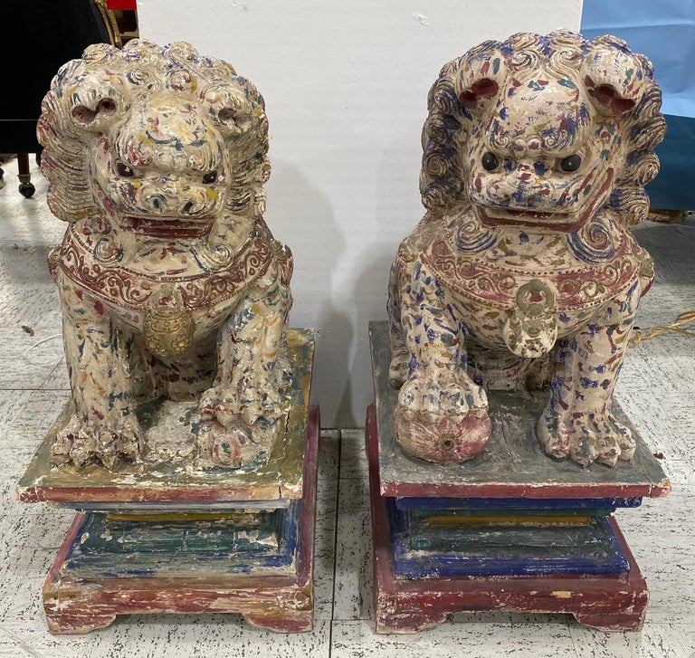 Great pair of polychrome carved wood foo dogs. Original paint and surface, great size.