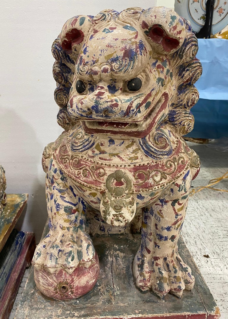 Chinese Export Great Pair of Polychrome Carved Wood Foo Dogs For Sale