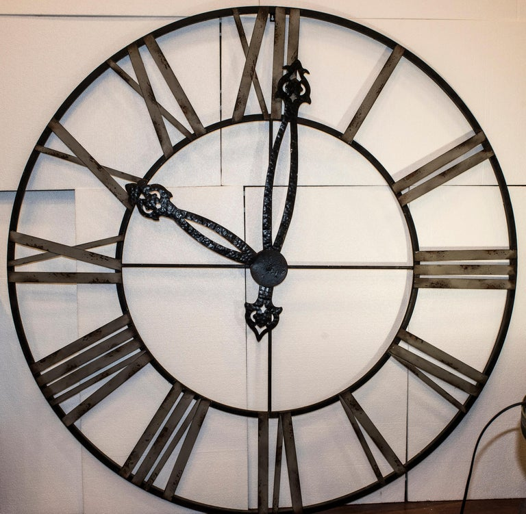 Great and very decorative hanging Skeleton iron clock, ideal in a Provencal French style or a glassed-in -garden. It could look  too beautiful  and funny in a kitchen  It comes from a important house in the south of France. At this moment there is