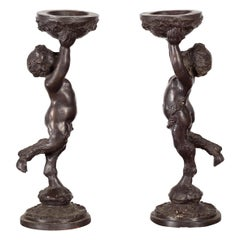 Greco-Roman Style Bronze Candle Holders Depicting Young Satyrs Holding Vessels
