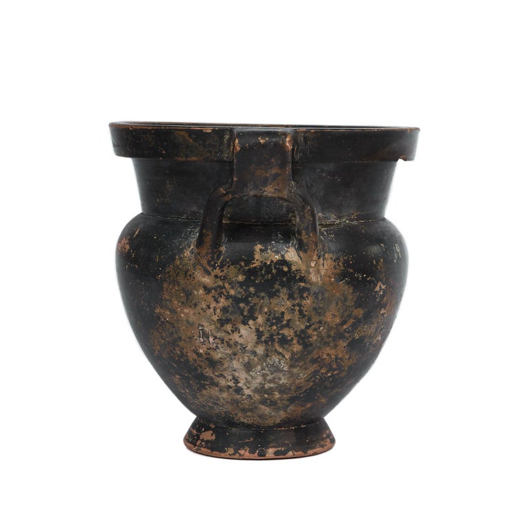 Black Glazen Column Krater mid-4th century BC, Apulia  With broad avoid body on a short echinus foot and thick mouth. The two handles form loops around the shoulders.  Resembling the Laconian style this vase is extremely rare due to the integrity of