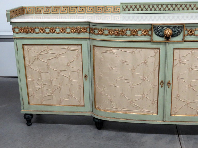 Greek key design distressed painted marble top sideboard with 4 drawers over 4 doors.