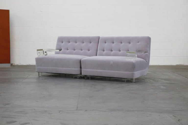 An amazing pair of reupholstered mohair 1960s club chairs, that when placed together create a loveseat, with Lucite Greek Key arms and base along with recently reupholstered lavender mohair. This Hollywood Regency pair of single-arm lounge chairs