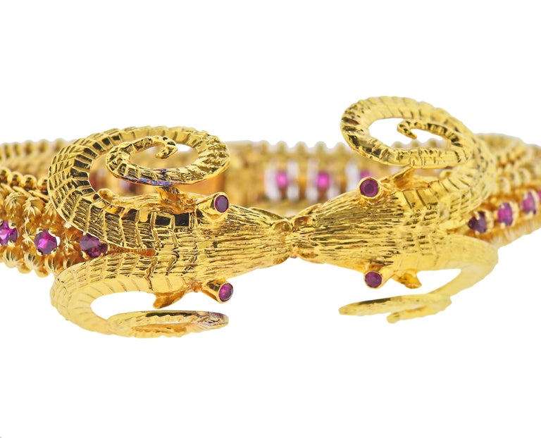 Greek made, 18k yellow gold bracelet, featuring two connecting ram's heads, decorated with rubies. Bracelet is 7