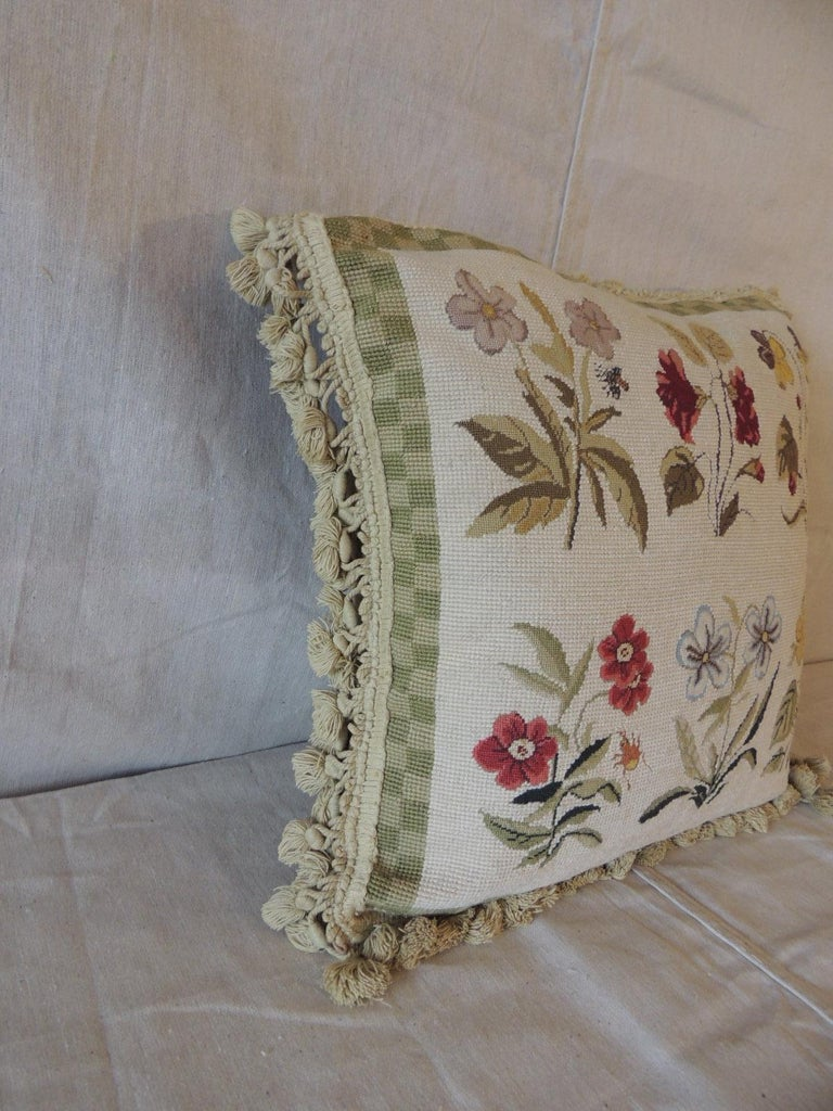 Green and natural woven floral tapestry decorative pillow with tassels. Floral pattern with various flowers, butterflies and insects. In shades of green, natural, green, blue. Taupe cotton velvet backing, Tassel trim all around. Decorative